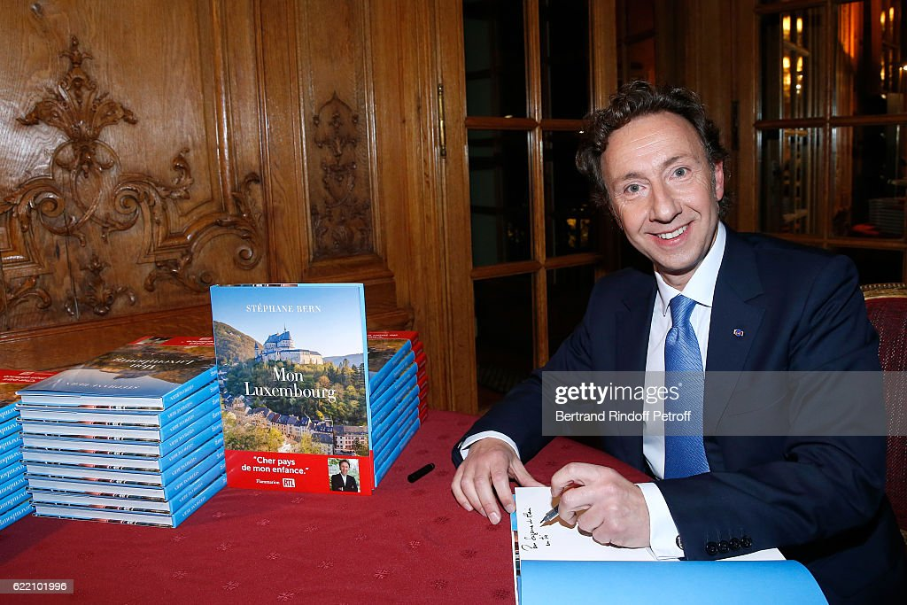"""Stephane Bern Signs His Book """"Mon Luxembourg"""" At Residence Of The Ambassador Of Luxembourg In Paris"""