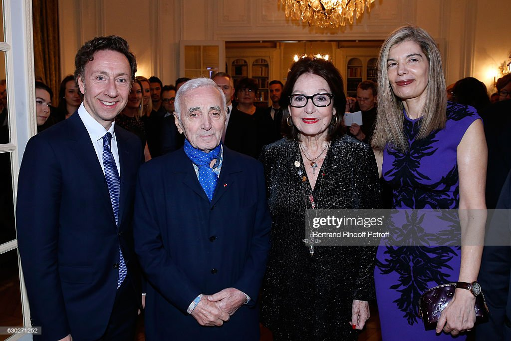Stephane Bern, singer Charles Aznavour, Nana Mouskouri and Ambassador of Greece in Paris, Maria Theofili attend Nana Mouskouri gives the Greek Prize 'Nikos Gatsos 2016' to Charles Aznavour at Embassy of Greece on December 19, 2016 in Paris, France.
