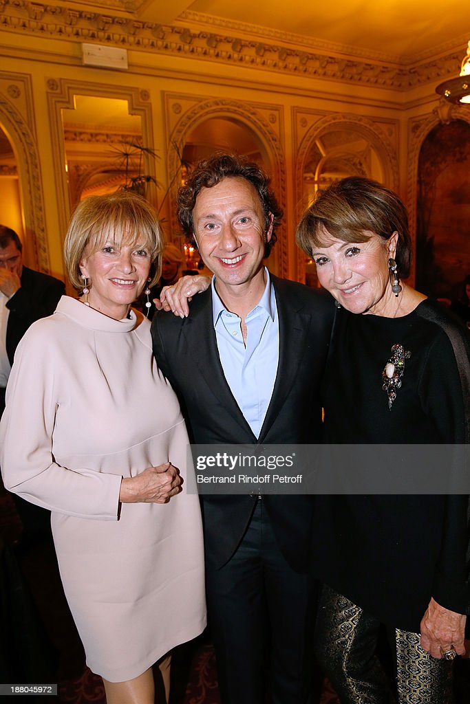 Stephane Bern stands between his 'substitute mothers' Eve Ruggiery (L) and Yaguel Didier attend the 50th Anniversary party of Stephane Bern, called 'Half a century, it's party', celebrated at Angelina on November 14, 2013 in Paris, France.