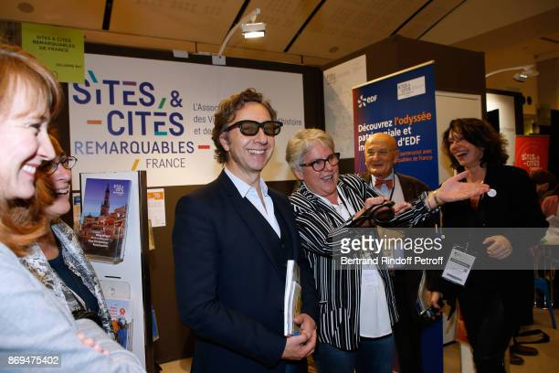 Stephane Bern trying 3D glasses during the Official Visit of Stephane Bern at the 'International Exhibition of Cultural Heritage Salon International...