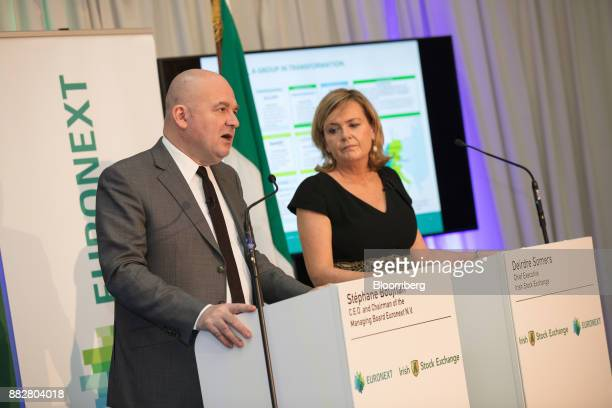Stephane Boujnah chief executive officer Euronext NV left speaks as Deirdre Somers chief executive officer of Irish Stock Exchange Plc right listens...