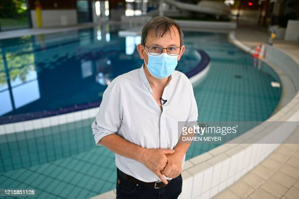 Stephane Chatenet director of La conterie public swimming pool poses close to a pool in ChartresdeBretagne suburbs of Rennes western France on May 28...
