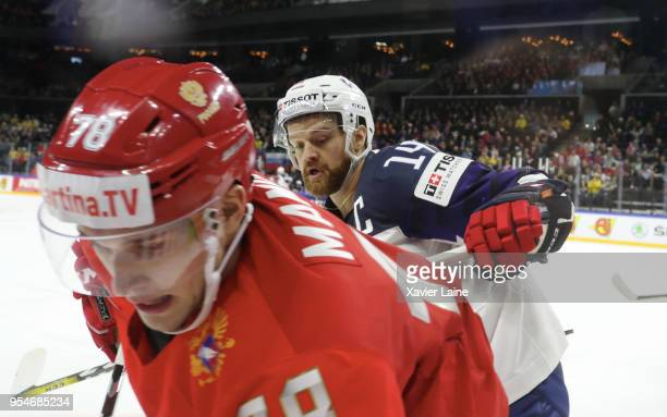 Stephane Da Costa of France slash Maxim Mamin of Russia during the 2018 IIHF Ice Hockey World Championship Group A between Russia and France at Royal...