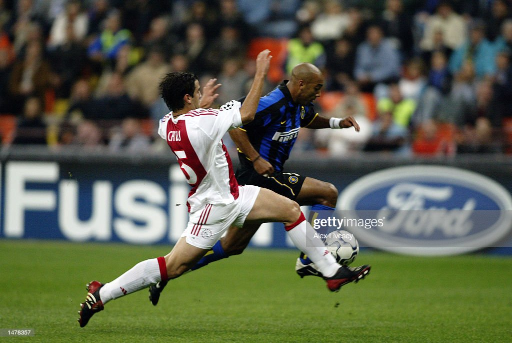 Stephane dalmat of inter milan and cristian chivu of ajax pictures stephane dalmat right of inter milan is tackled by cristian chivu left thecheapjerseys Image collections