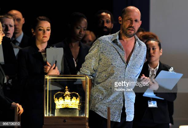 Stephane Degout as King with artists of the company in the Royal Opera's production of Martin Crimp's Lessons in Love and Violence directed by Katie...