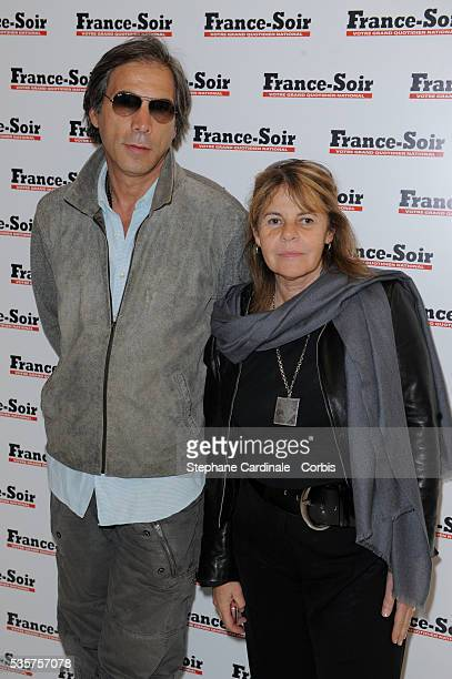 Stephane Ferrara and Dominique Cantien attend France Soir New Office Opening at the 100 Champs Elysees in Paris