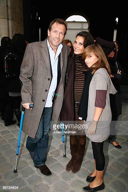 Stephane Freiss his wife Ursula and their daughter Camille leave the Louis Vuitton fashion show during Paris Fashion Week Spring/Summer '09 on...