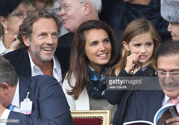 Stephane Freiss his wife Ursula Freiss and their daughter Bianca Freiss attend the Qatar Prix de I'Arc de Triomphe at Longchamp racecourse on October...