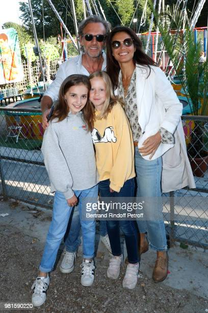 Stephane Freiss his wife Ursula with their daughters Camille and Bianca attend the Fete Des Tuileries on June 22 2018 in Paris France