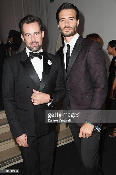 Stephane Gerschel and Giulio Berruti walk the red carpet of amfAR Milano 2016 at La Permanente on September 24 2016 in Milan Italy