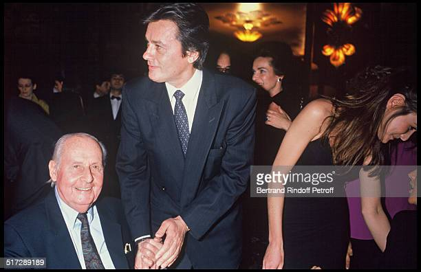 Stephane Grappelli and Alain Delon at the party organized by the 'Elle' magazine