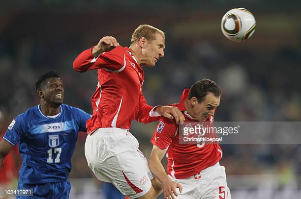 Stephane Grichting and Steve von Bergen of Switzerland jump for the ball during the 2010 FIFA World Cup South Africa Group H match between...