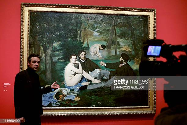 Stephane Guegan commissioner of the exhibition 'Manet inventeur du moderne' presents the painting 'Le dejeuner sur l'herbe' made on 1863 by French...