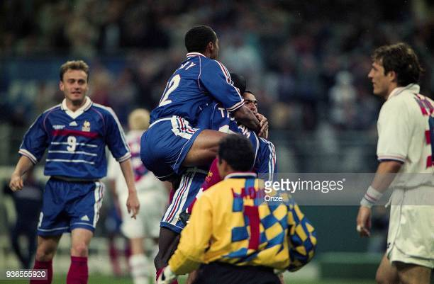 Stephane Guivarch Thierry Henry Lilian Thuram and Youri Djorkaeff of France celebrates the victory during the Soccer World Cup semi final match...