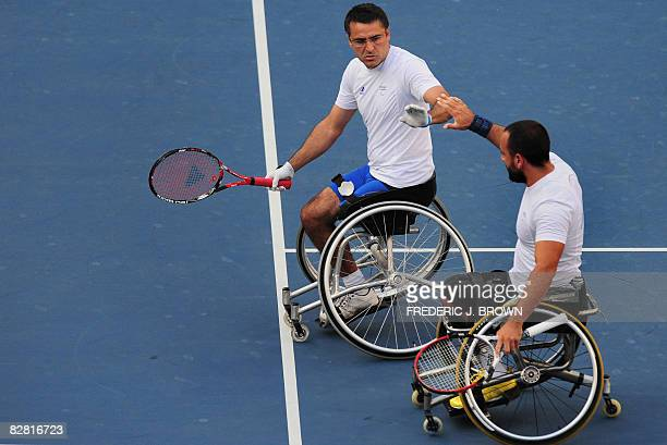 Stephane Houdet and Michael Jeremiasz of France celebrate a point won against Sweden's Stefan Olsson and Peter Wikstrom in the men's wheelchair...