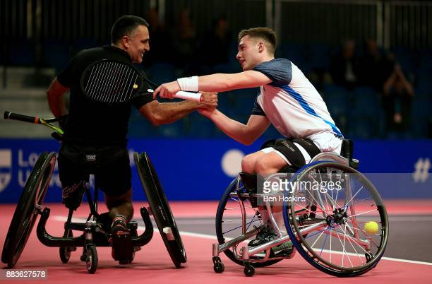 Stephane Houdet of France and Alfie Hewett of Great Britain shake hands following their match on day 3 of The NEC Wheelchair Tennis Masters at...