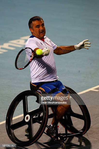 Stephane Houdet of France in action against Shingo Kunieda of Japan in the Mens Wheelchair Gold Medal match on day 10 of the London 2012 Paralympic...