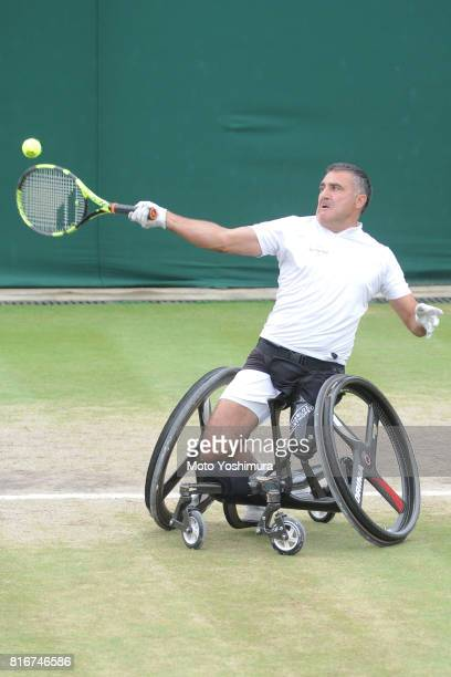 Stephane Houdet of France plays a forehand during the Gentlemen's wheel chair doubles final against Gordon Reid and Alfie Hewett of Great Britain on...