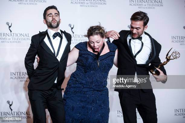 Stephane Kaas Marloes Blokker and Erich Bergen give a pose with their award during the 46th International Emmy Awards at New York Hilton on November...