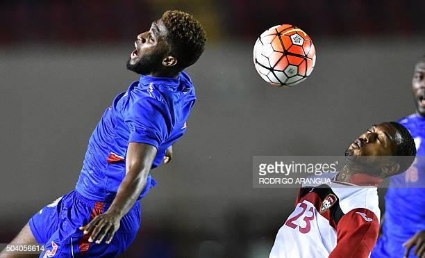 Stephane Lambese of Haiti vies for the ball with Lester Peltier of Trinidad and Tobago during a playoff for the Copa America 2016 tournament, in...