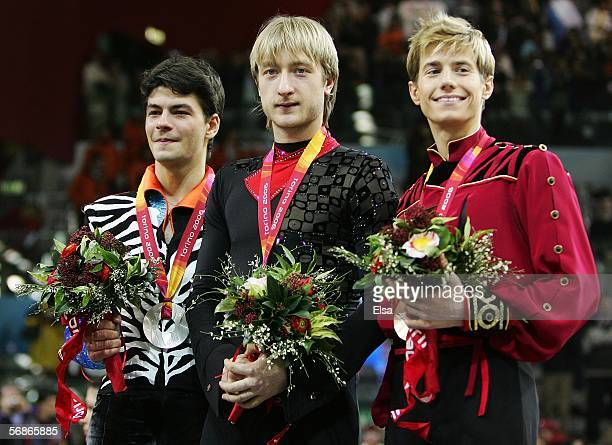 Stephane Lambiel of Switzerland wins the silver medal Evgeni Plushenko of Russia wins the gold medal and Jeffrey Buttle of Canada wins the bronze...
