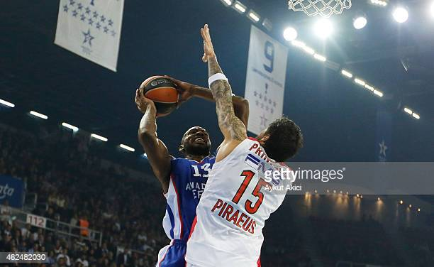 Stephane Lasme #13 of Anadolu Efes Istanbul competes with Georgios Printezis #15 of Olympiacos Piraeus during the Euroleague Basketball Top 16 Date 5...