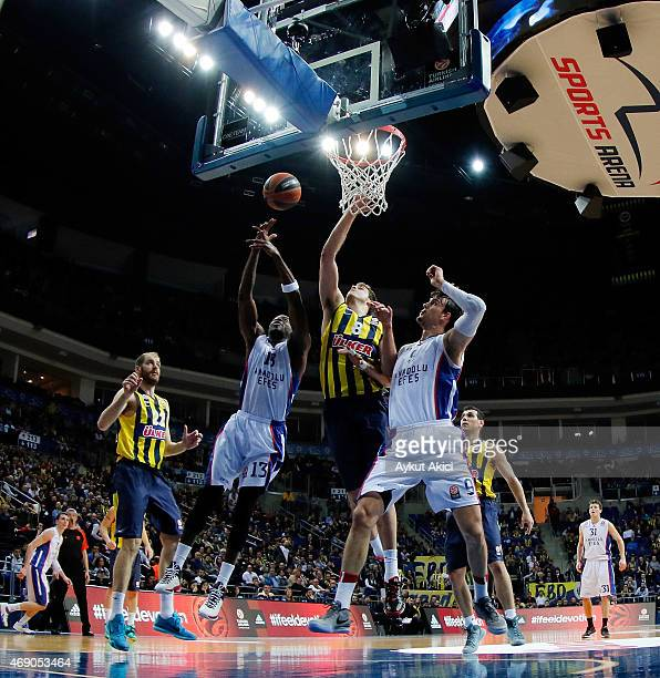 Stephane Lasme #13 of Anadolu Efes Istanbul competes with Nemanja Bjelica #8 of Fenerbahce Ulker Istanbul during the Turkish Airlines Euroleague...