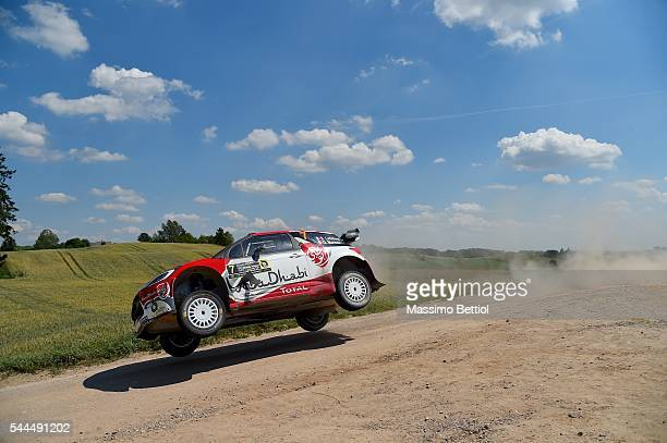 Stephane Lefebvre of France and Gabin Maurin of France compete in their Abu Dhabi Total WRT Citroen DS3 WRC during Day Two of the WRC Poland on July...