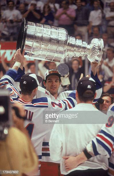 Stephane Matteau of the New York Rangers holds the Stanley Cup Trophy after defeating the Vancouver Canucks in Game 7 of the 1994 Stanley Cup Finals...