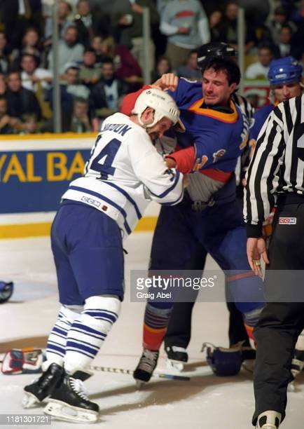 Stephane Matteau of the St Louis Blues battles against Jamie Macoun of the Toronto Maple Leafs during NHL game action on December 3 1996 at Maple...