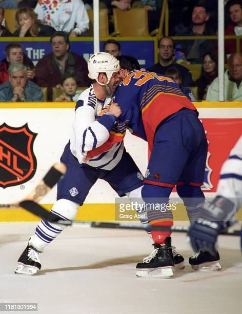 Stephane Matteau of the St Louis Blues skates against Jamie Macoun of the Toronto Maple Leafs during NHL game action on December 3 1996 at Maple Leaf...
