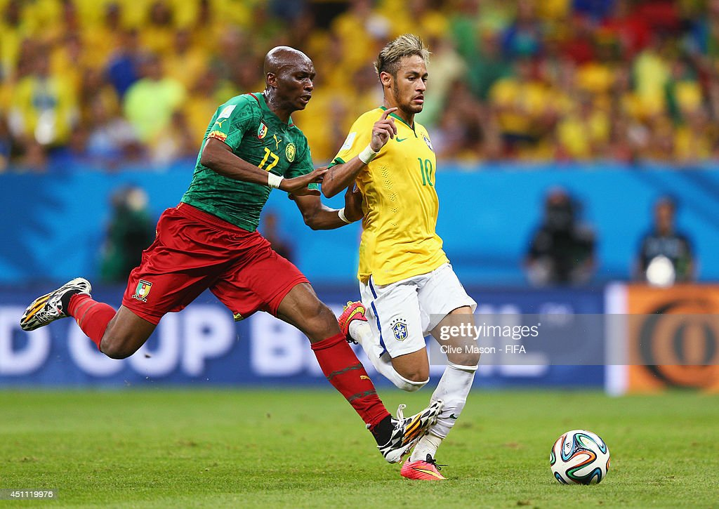 Stephane Mbia of Cameroon challenges Neymar of Brazil during the 2014 FIFA World Cup Brazil Group A match between Cameroon and Brazil at Estadio Nacional on June 23, 2014 in Brasilia, Brazil.