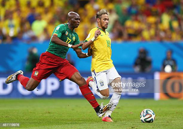 Stephane Mbia of Cameroon challenges Neymar of Brazil during the 2014 FIFA World Cup Brazil Group A match between Cameroon and Brazil at Estadio...