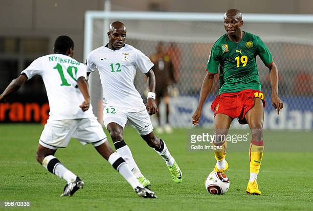 Stephane Mbia of Cameroon comes under pressure from James Chamanga and Thomas Nyirenda of Zambia during the African Nations Cup group D match between...