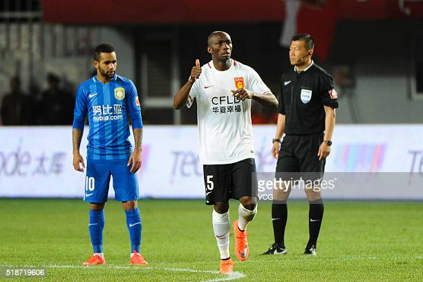 Stephane M'Bia of Hebei China Fortune and Alex Teixeira of Jiangsu Suning react during the round three match of CSL Chinese Football Association...
