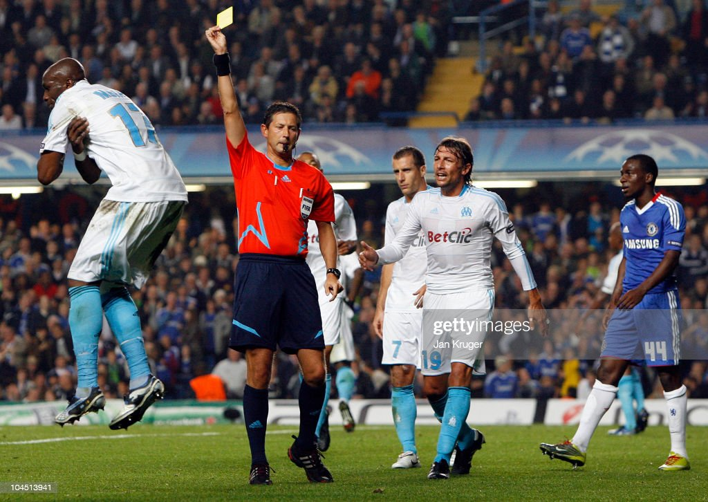 Stephane Mbia of Marseille (L) shows his disappointment to Referee, Frank de Bleeckere after conceding a penalty for handball during the UEFA Champions League Group F match between Chelsea and Marseille at Stamford Bridge on September 28, 2010 in London, England.