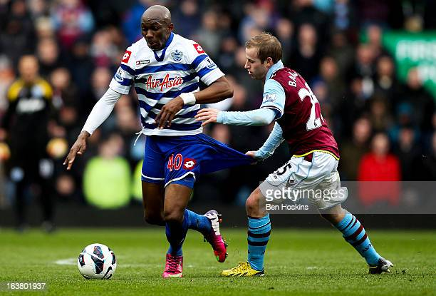 Stephane M'Bia of QPR holds off the challenge of Barry Bannan of Aston Villa during the Barclays Premier League match between Aston Villa and Queens...