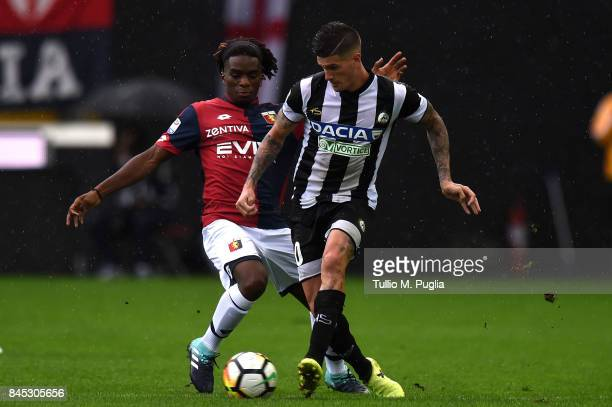 Stephane Omeonga of Genoa and Rodrigo Javier De Paul of Udinese compete for the ball during the Serie A match between Udinese Calcio and Genoa CFC at...