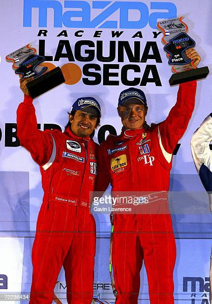Stephane Ortelli and Mika Salo drivers of the Riso Competizione Ferrari 430 GT Berlinetta celebrate after winning the GT2 category during the...