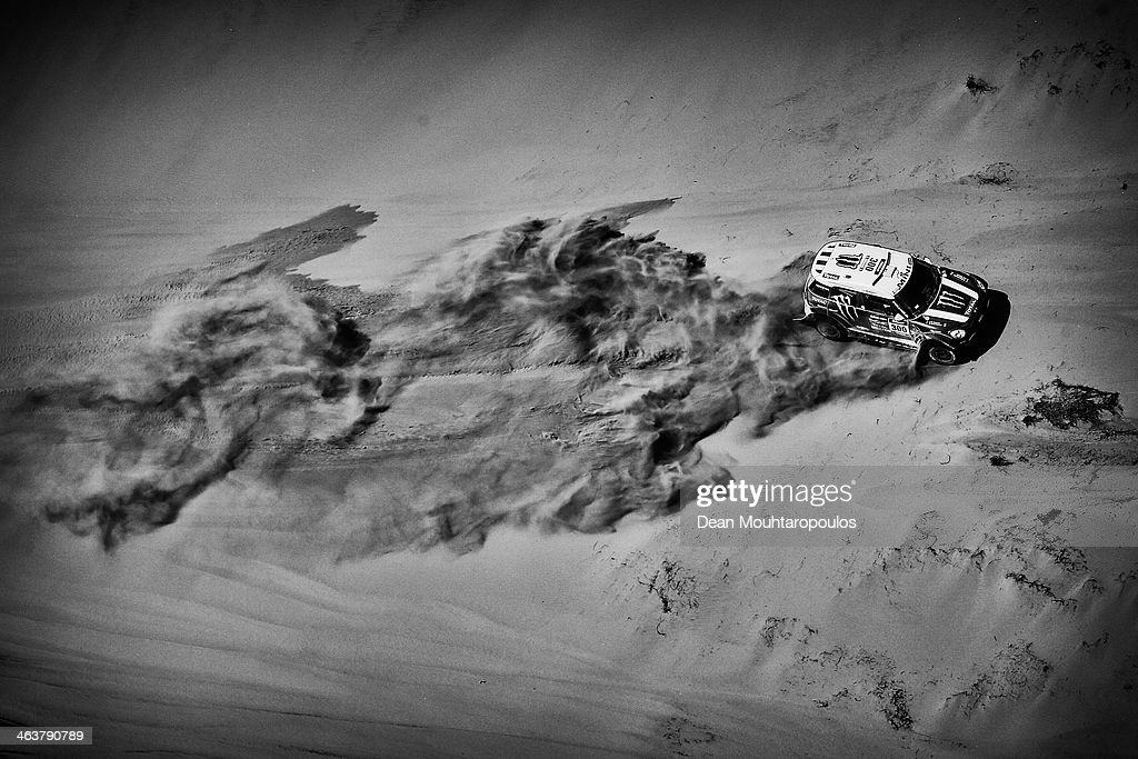 Stephane Peterhansel and Jean Paul Cottret of France for Mini Monster Energy X-Raid Team compete in stage 12 on the way to La Serena during Day 13 of the 2014 Dakar Rally on January 17, 2014 in El Salvador, Chile.