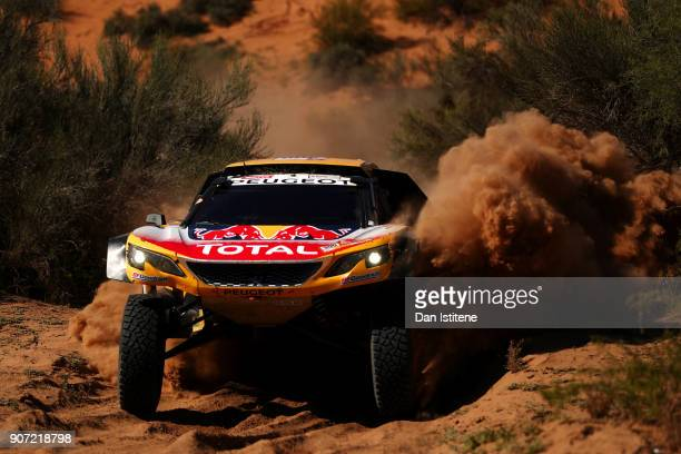 Stephane Peterhansel of France and Peugeot Total drives with codriver Jean Paul Cottret of France in the 3008 DKR Peugeot car in the Classe T14 2...