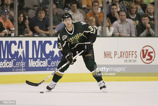 Stephane Robidas of the Dallas Stars plays the puck against the Vancouver Canucks during game three of the 2007 NHL Western Conference Quarterfinals...