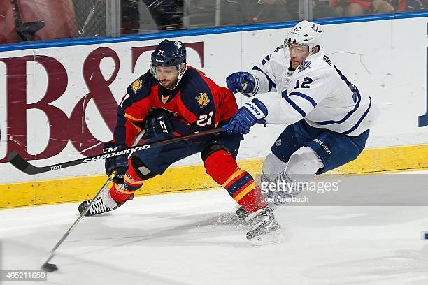 Stephane Robidas of the Toronto Maple Leafs defends against Vincent Trocheck of the Florida Panthers late in the third period at the BBT Center on...