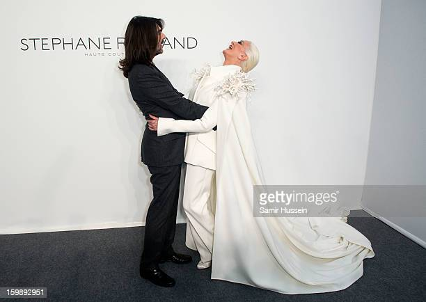 Stephane Rolland and Carmen Dell'Orefice pose backstage at the Stephane Rolland Spring/Summer 2013 HauteCouture show as part of Paris Fashion Week at...