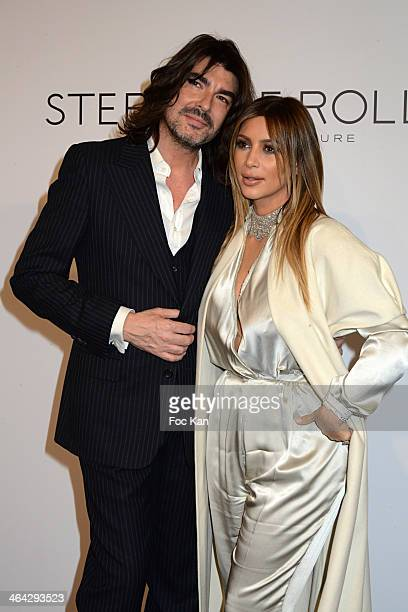 Stephane Rolland and Kim Kardashian attend the Stephane Rolland show during Paris Fashion Week - Haute Couture S/S 2014 at Theatre National de...