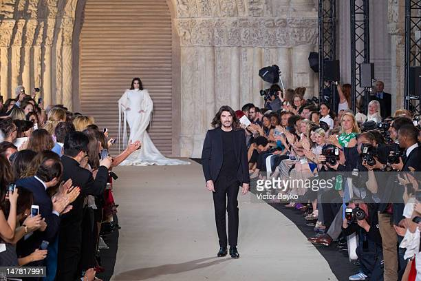 Stephane Rolland walks the runway during the Stephane Rolland Haute-Couture Show as part of Paris Fashion Week Fall / Winter 2013 at Cite de...