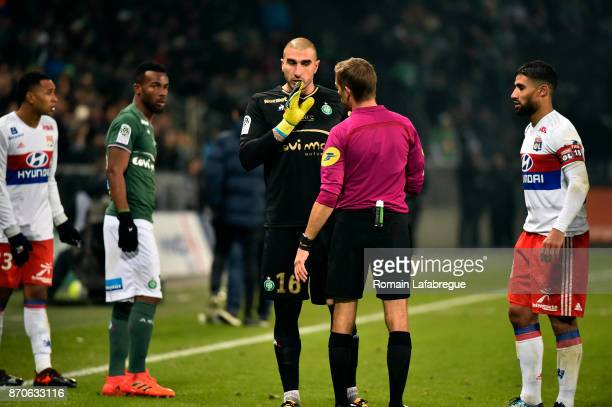 Stephane Ruffier of Saint Etienne speaks with the referee Clement Turpin during the Ligue 1 match between AS SaintEtienne and Olympique Lyonnais at...