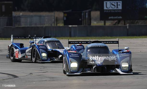 Stephane Sarrazin of France drives the Peugeot Sport Total Peugeot 908 in front of Marc Gene of Spain in the Peugeot during practice for the...