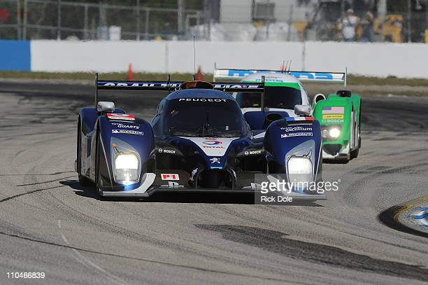 Stephane Sarrazin of France drives the Peugeot Sport Total Peugeot 908 during practice for the Intercontinental Le Mans Cup 12 Hours of Sebring, at...