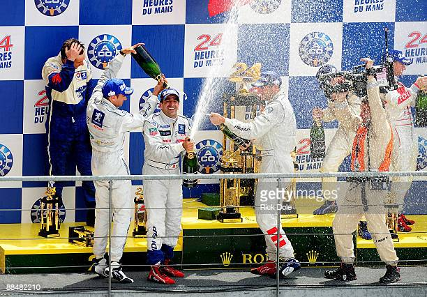 Stephane Sarrazin of France Marc Gene of Spain and Alexander Wurz of Austria celebrating on the podium following Peugeot Sport Total's onetwo finish...